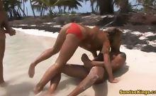 Two guys fucks blondie hard on the beach