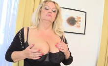 Blonde mature woman plays with her large boobs
